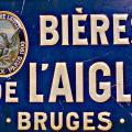 Emailplaat L'Aigle 1900